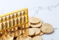 golden-abacus-with-chinese-rmb-gold-coins-as-background_1387-45