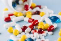 colorful-pills-plastic-bottle_23-2147983117